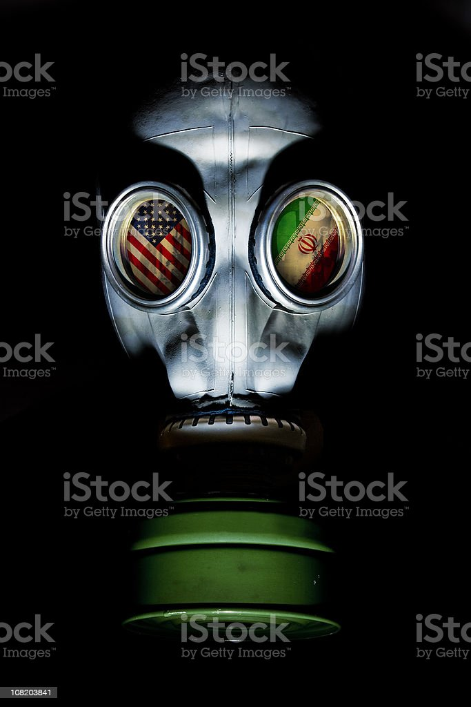 Gas Mask with American and Iran Flag in Eye Socket royalty-free stock photo