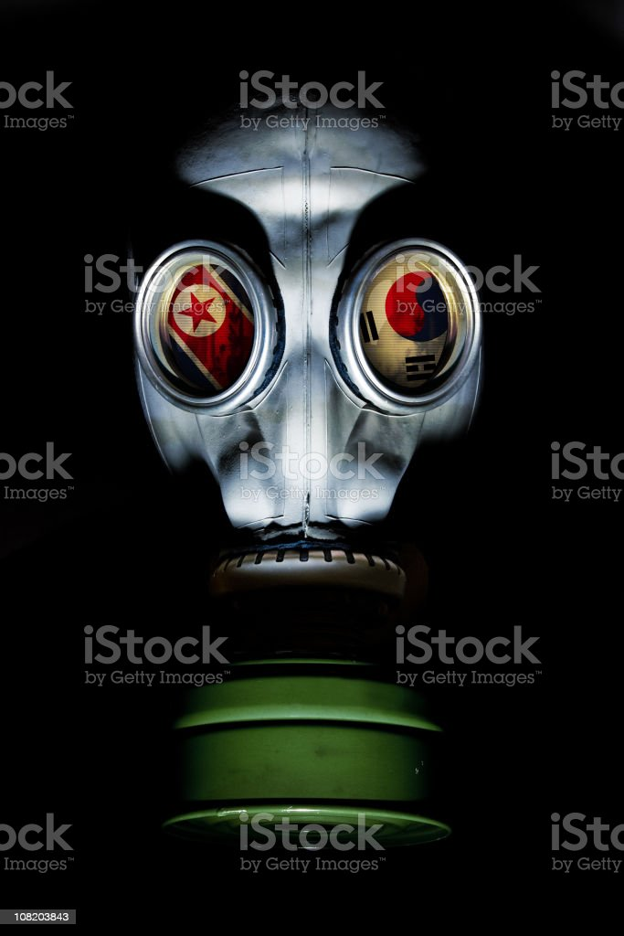 Gas Mask with North/South Korean Flags in Eye Sockets stock photo
