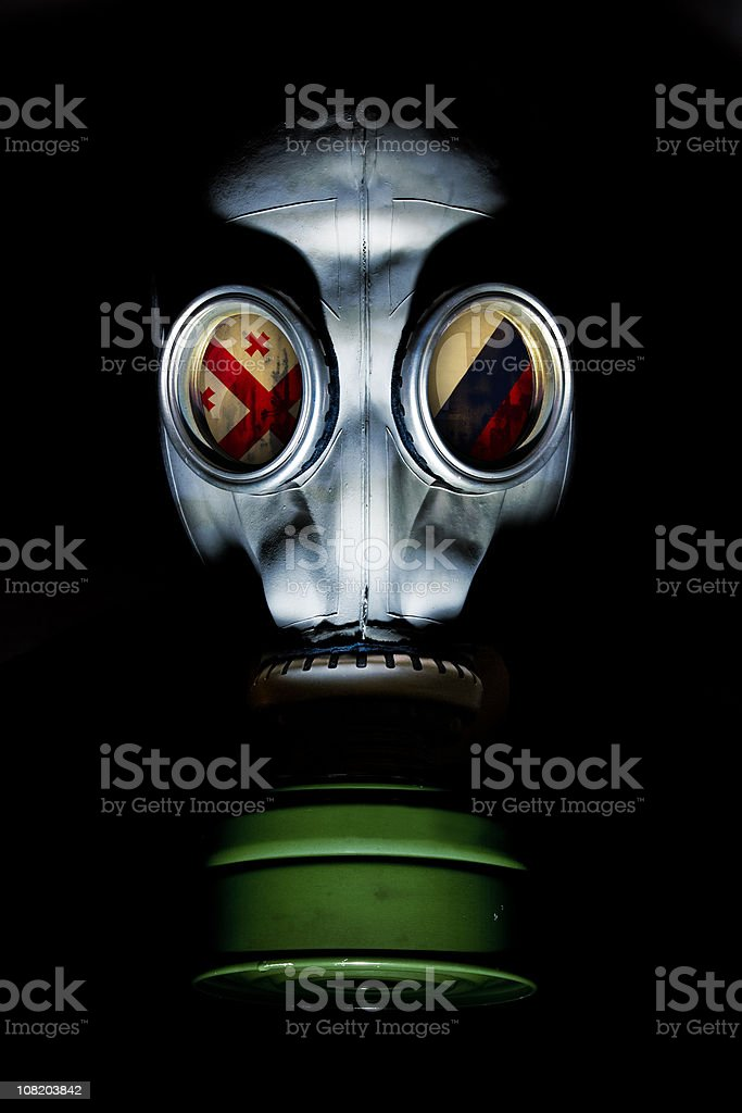 Gas Mask with Russian and Georgian Flag in Eye Socket stock photo