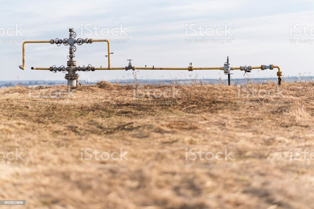 Gas pipeline in the middle of the field. Extraction of gas from storage. stock photo