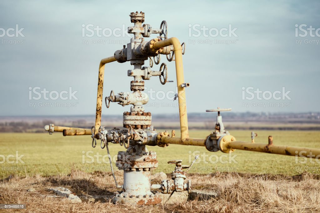 Gas pipeline middle of the field. Extraction of gas from storage. stock photo