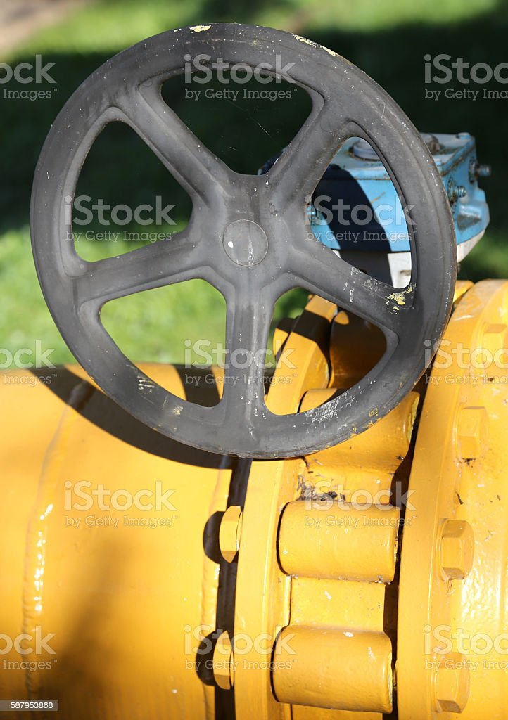 gas pipeline with bolts and the shut-off valve stock photo