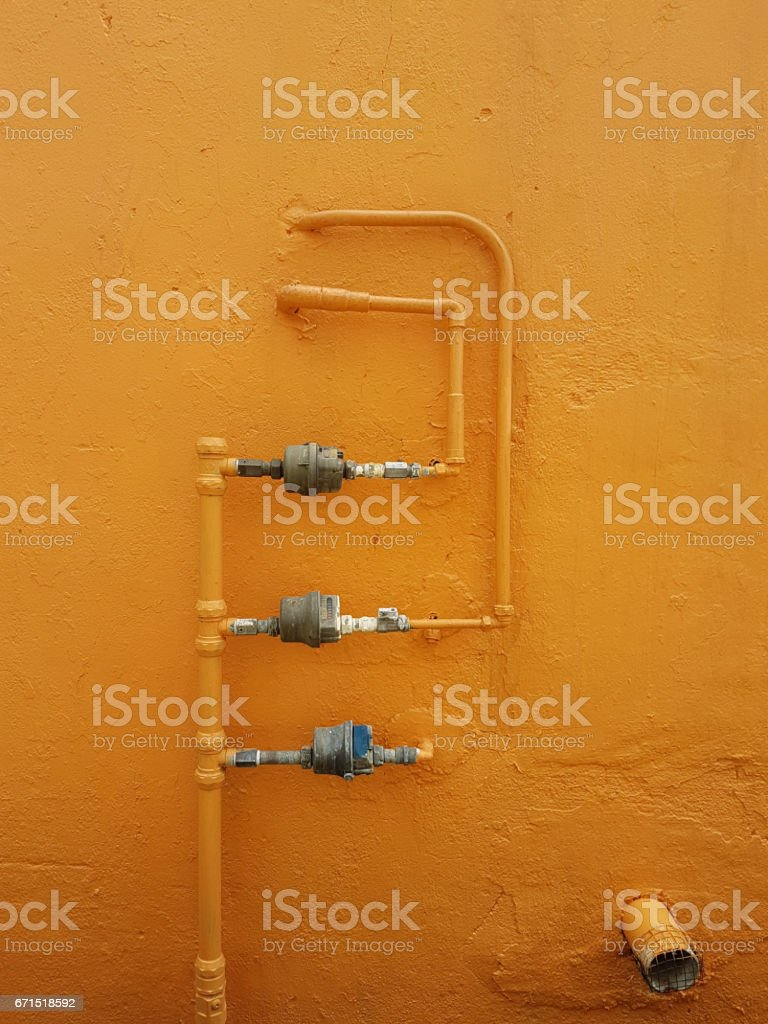 Gas pipes - Orange Background stock photo
