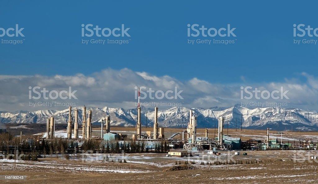 Gas plant near Canadian Rockies royalty-free stock photo