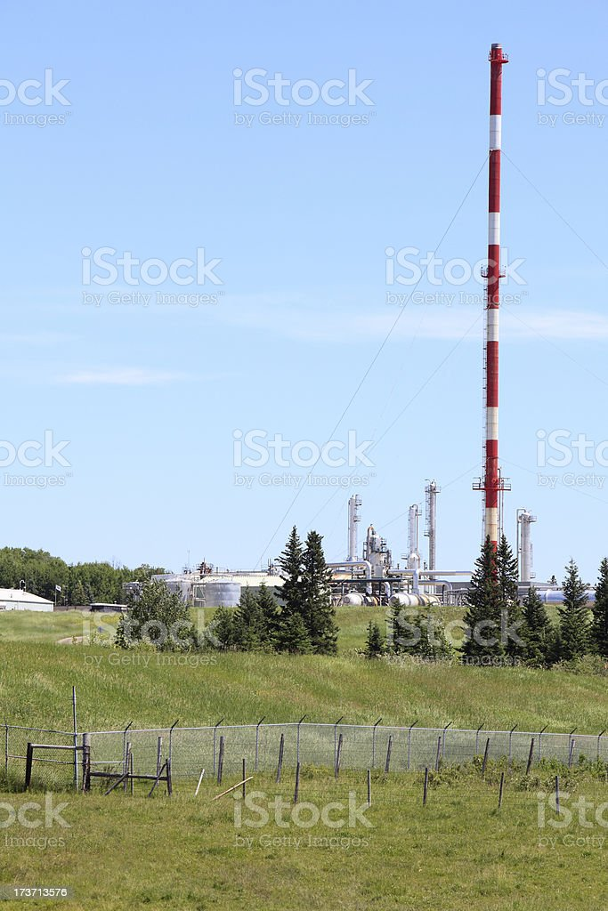 Gas Plant With Flare Stack In Natural Land Scape royalty-free stock photo