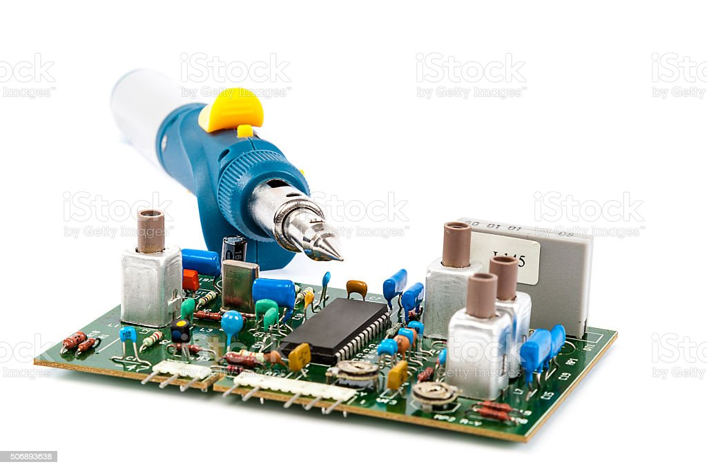 Gas Powered Soldering and electronic board. stock photo