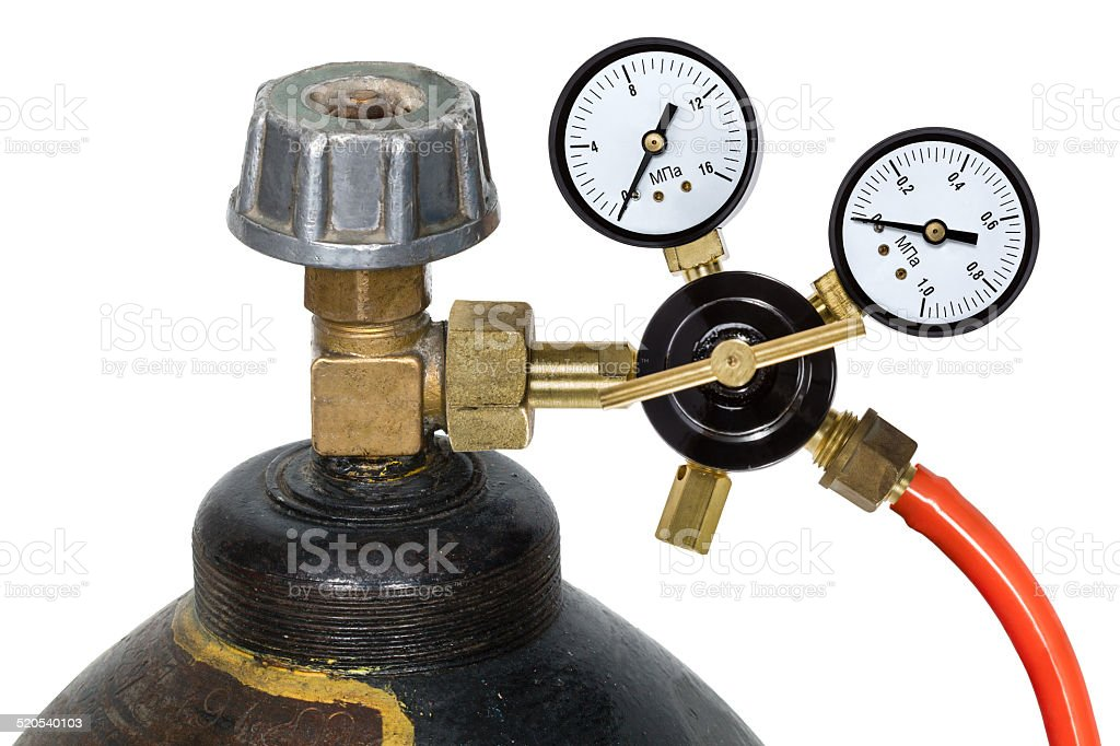 Gas pressure regulator with manometer, isolated on white background stock photo