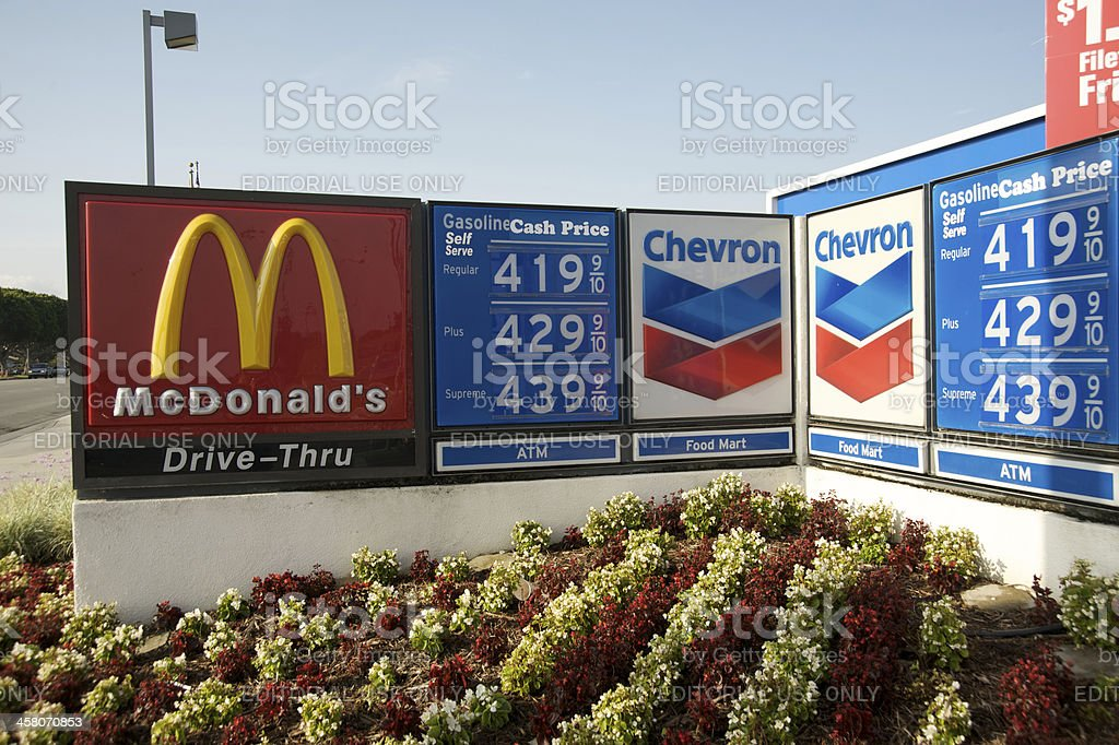 Gas prices McDonald's Chevron going up royalty-free stock photo