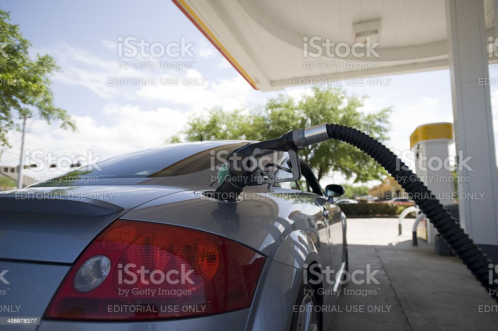 Gas pump in sports car stock photo