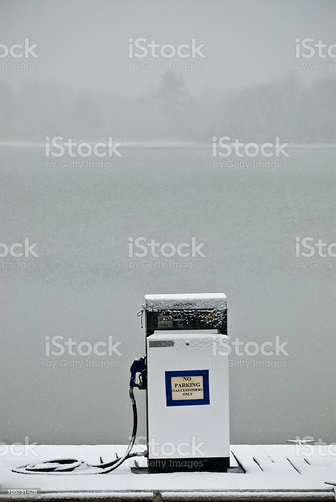 Gas Pump in winter storm stock photo