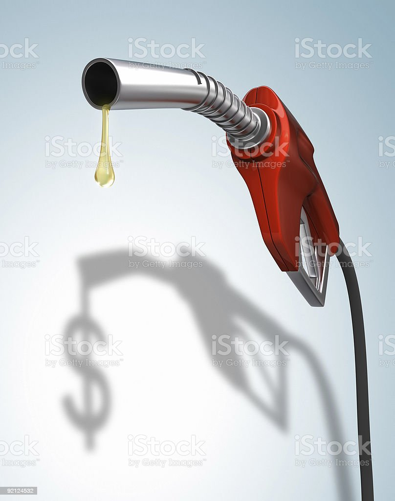 Gas pump nozzle with $ sign dripping from it stock photo