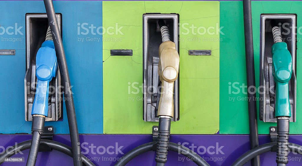 Gas pump nozzles in a service station stock photo