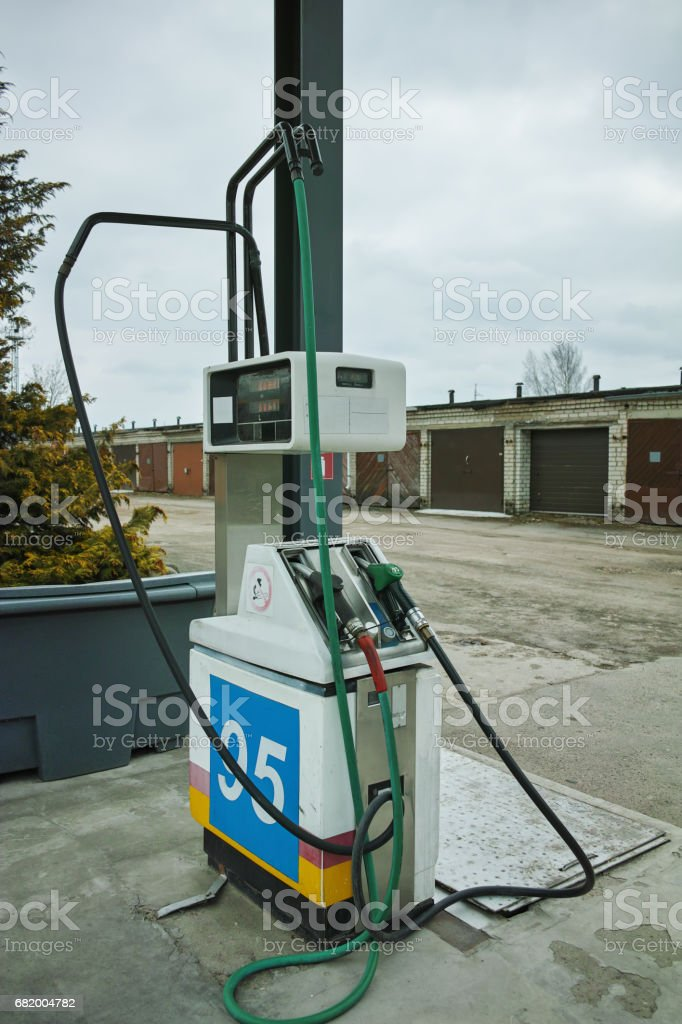 Gas station and pump nozzles stock photo