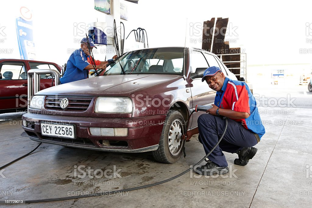 Gas station attendants at work royalty-free stock photo