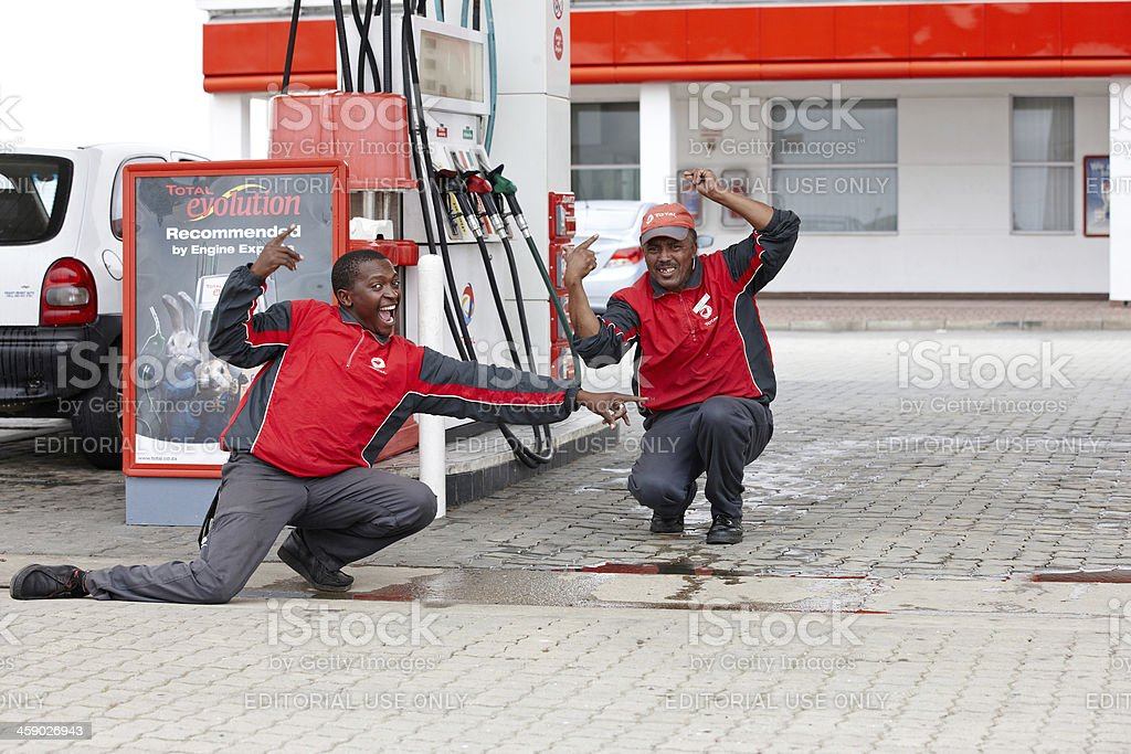 Gas station attendants royalty-free stock photo