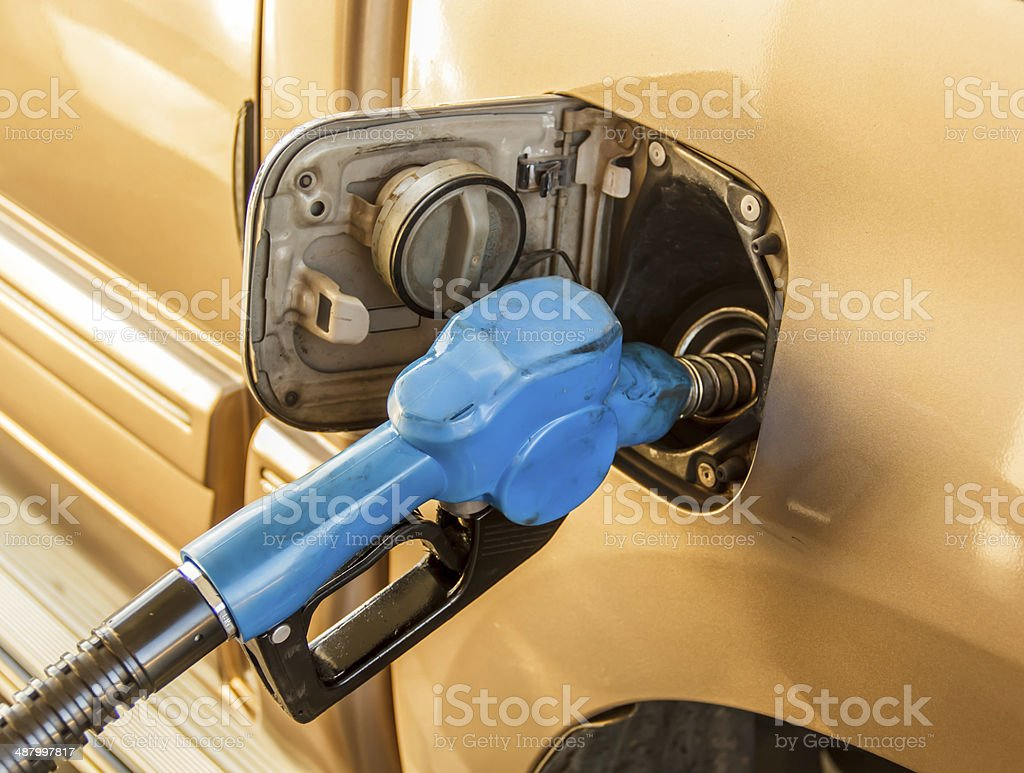 gas station being filled with fuel stock photo