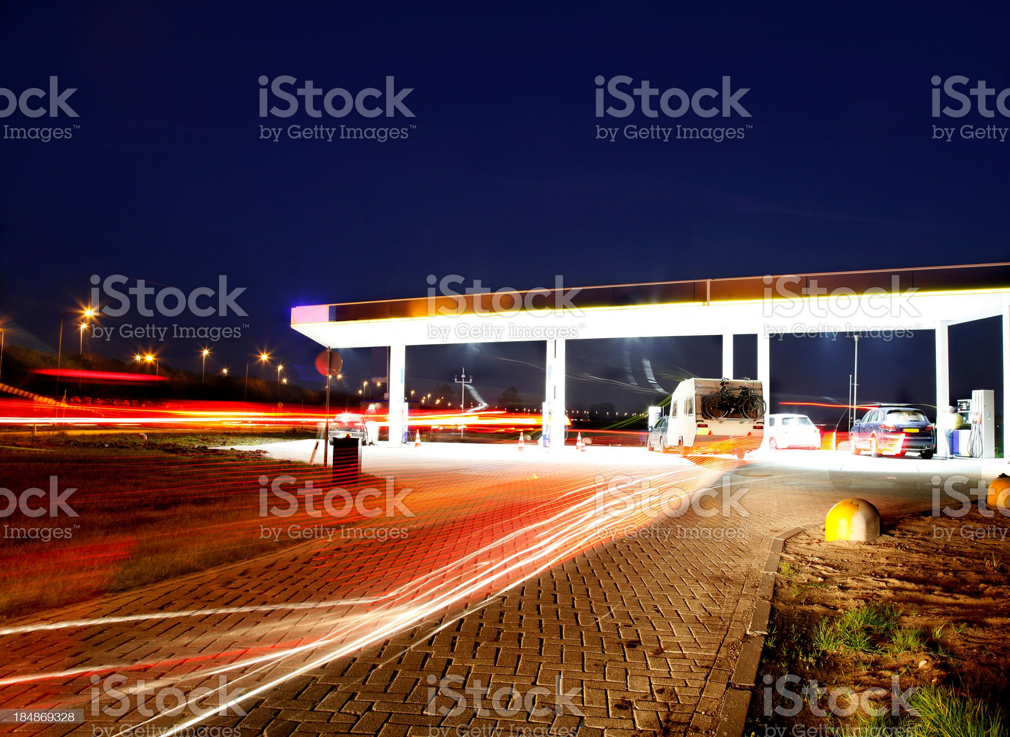 A gas station off of a main highway at night royalty-free stock photo