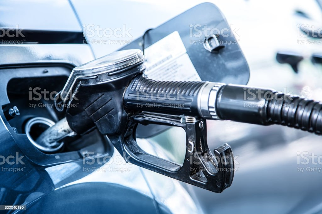 Gas station. Pumping the fuel diesel or petrol on gas station stock photo