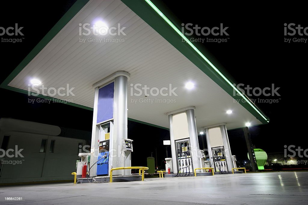 Gas station shot from below at night stock photo