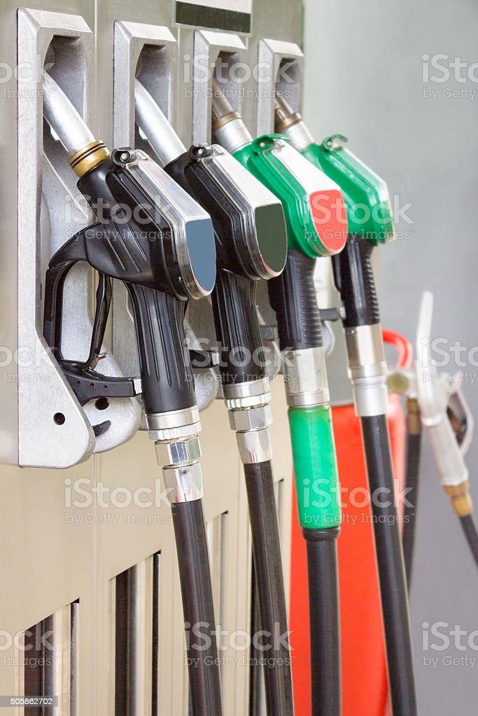 Gas station with pistol grips for gasoline and diesel stock photo
