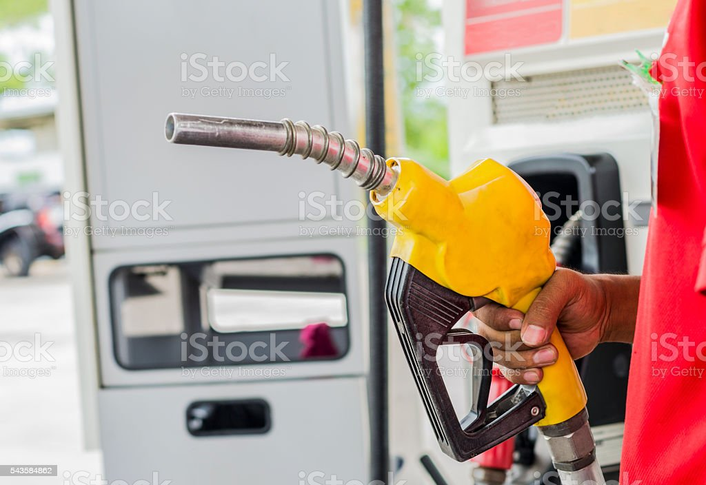 Gas Station Worker and service stock photo