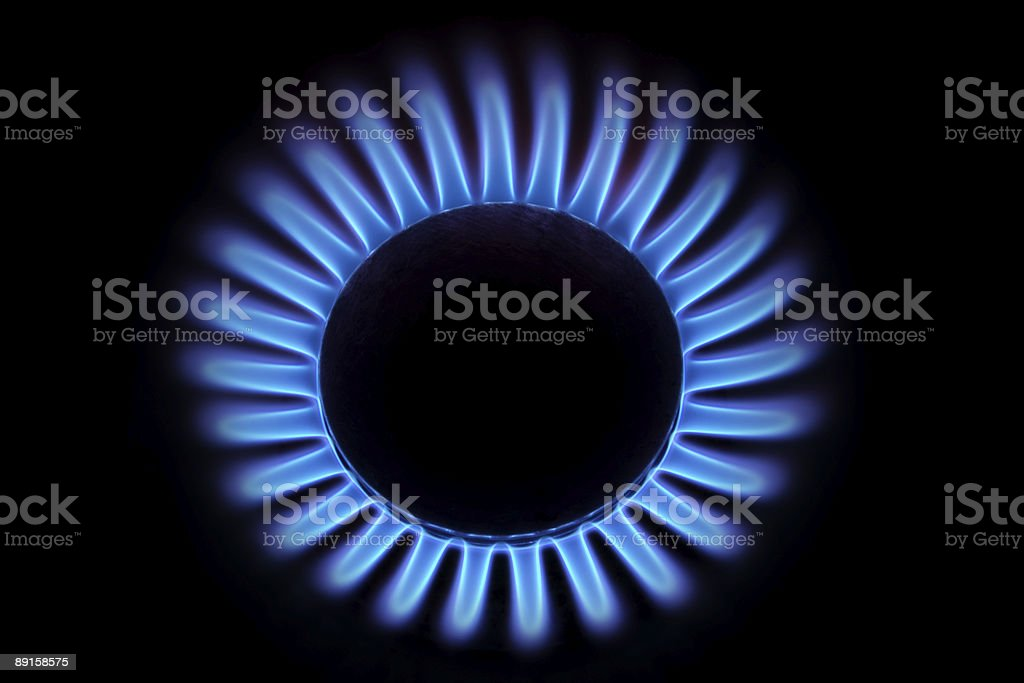 Gas Stove from above (Blue Flames on Black) stock photo