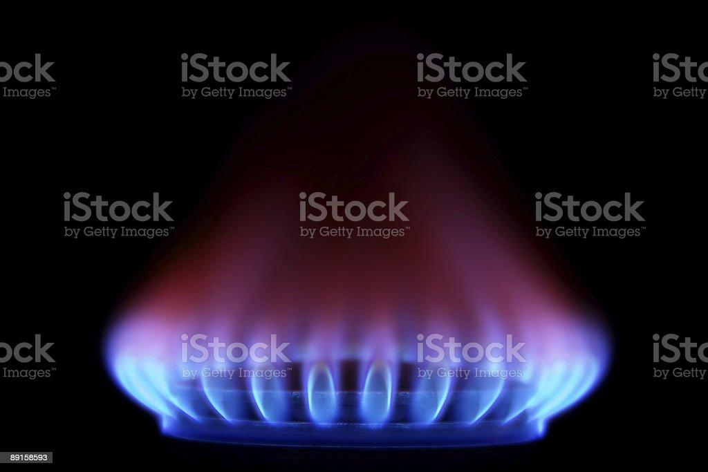 Gas Stove from side  (Blue Flames on Black) stock photo