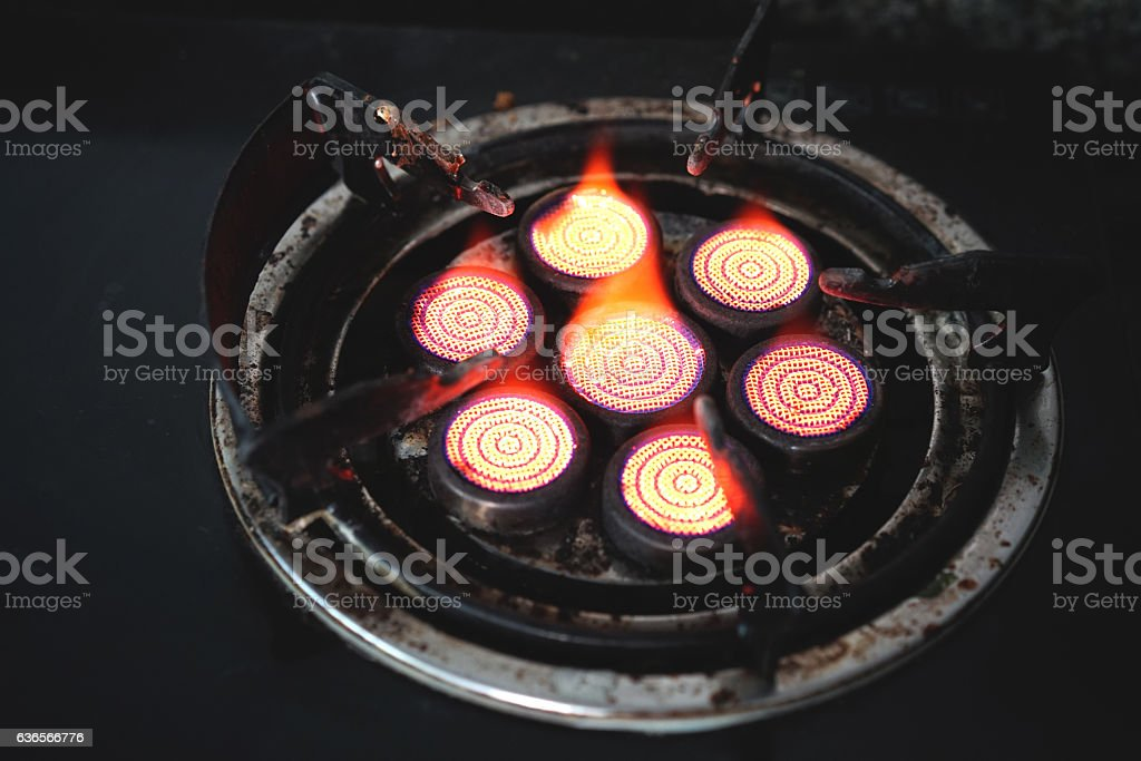 gas stove with fire stock photo