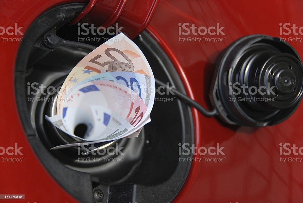 Gas tank eats money royalty-free stock photo