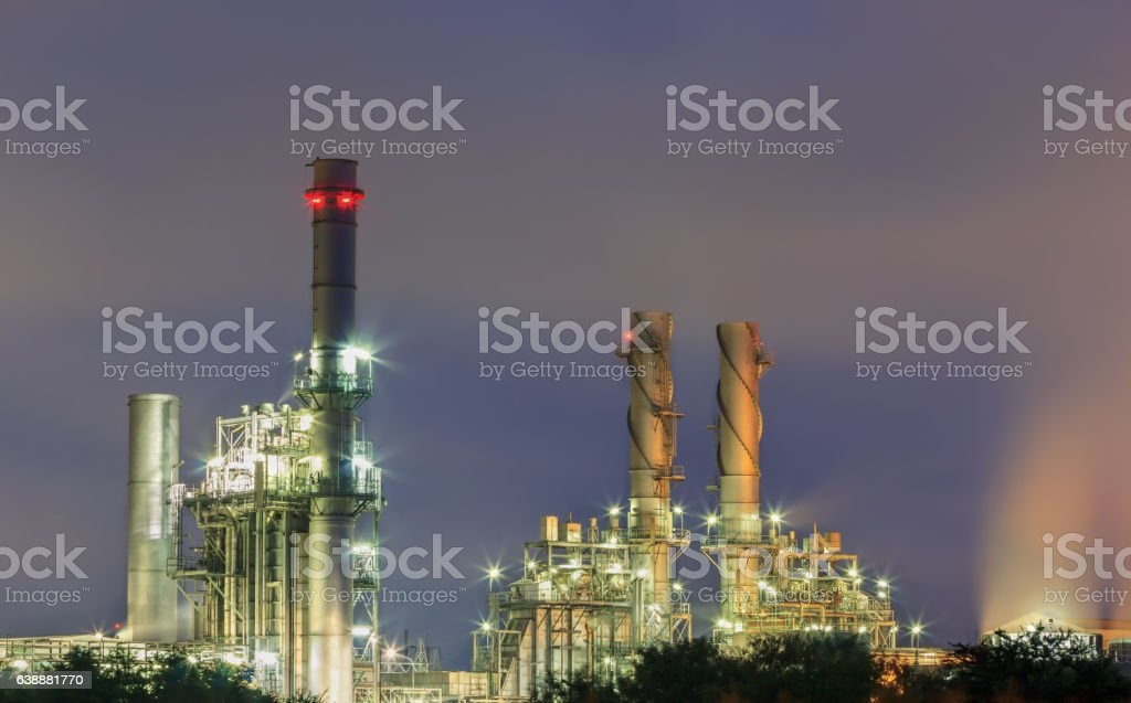 Gas turbine electrical power plant steam from cooling tower. stock photo