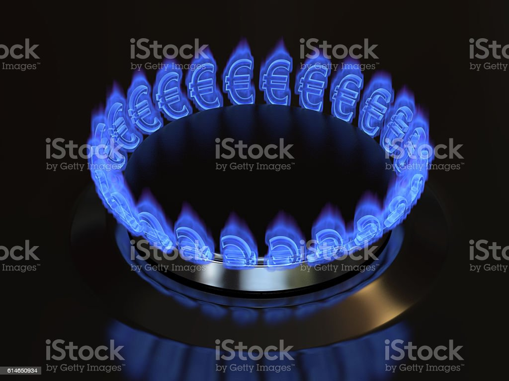 Gas with a euro sign burns from the kitchen stove. stock photo