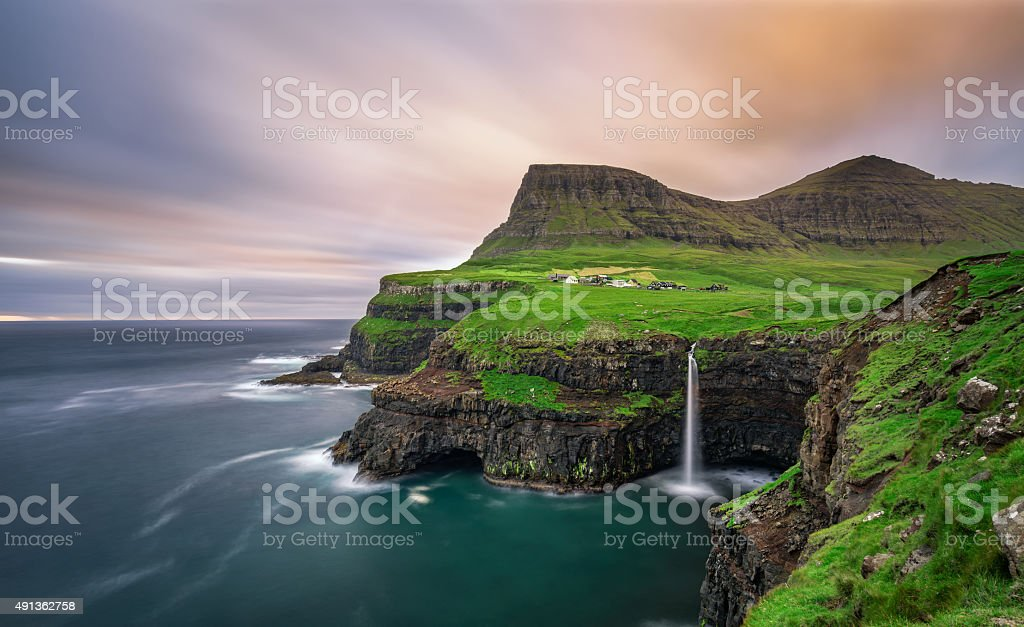 Gasadalur village and its waterfall, Faroe Islands, Denmark stock photo