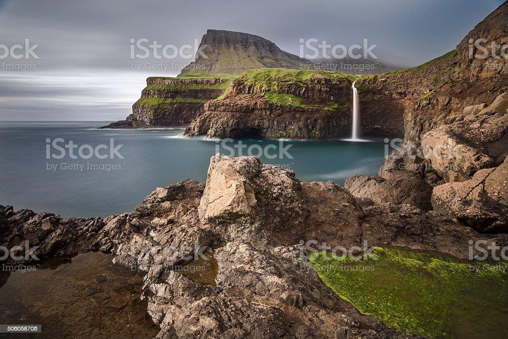 Gasadalur village and its waterfall, Faroe Islands, Denmark stock photo