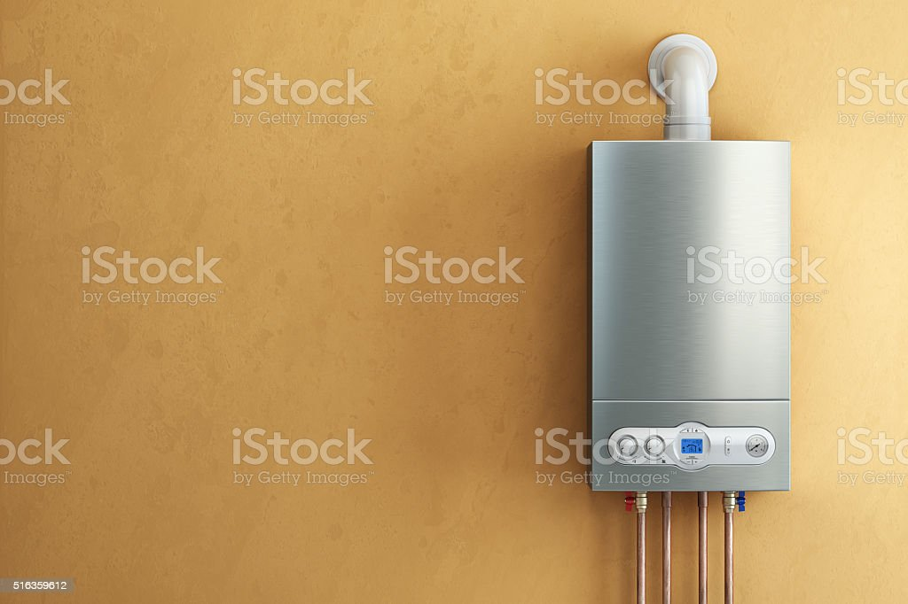 Gas-fired boiler on yellow background. Home heating. stock photo