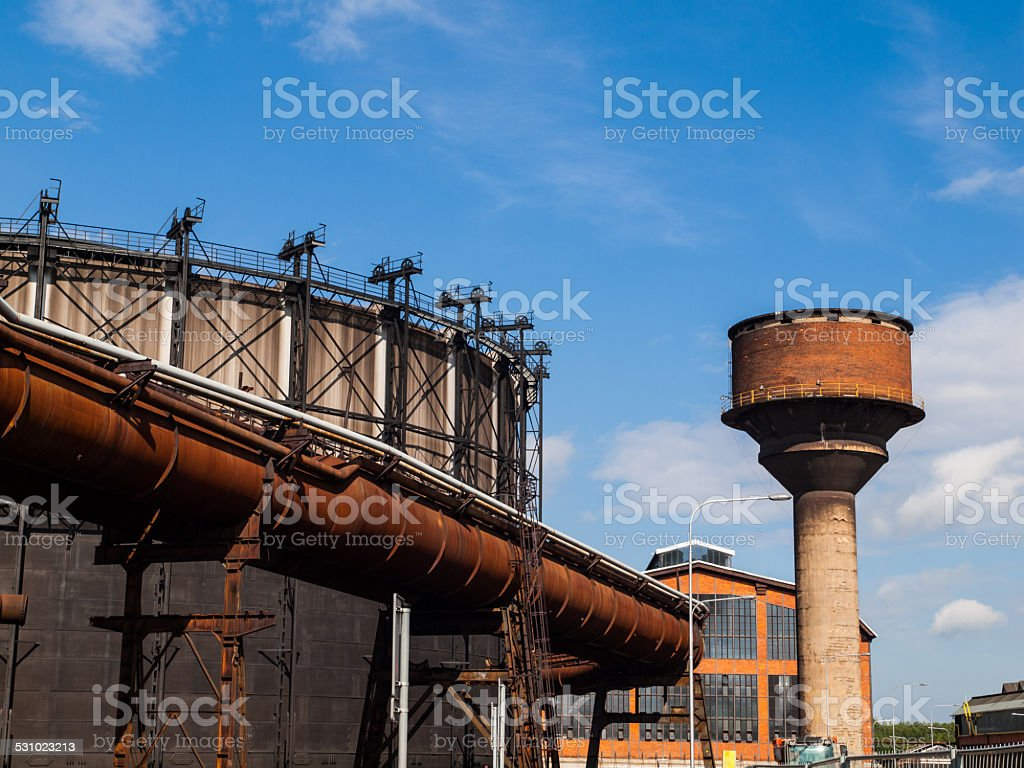 Gasholder and water tower in the industrial zone stock photo