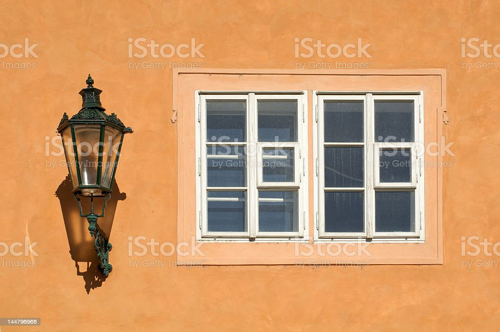 Gas-lamp and wooden framed window royalty-free stock photo
