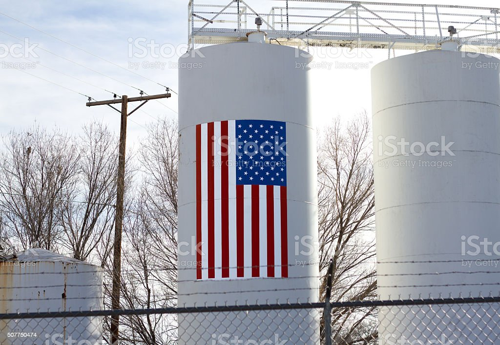 Gas/Oil Storage Tanks, One with Painted US Flag stock photo