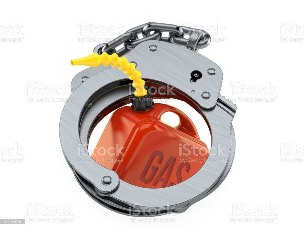 Gasoline can with handcuffs stock photo