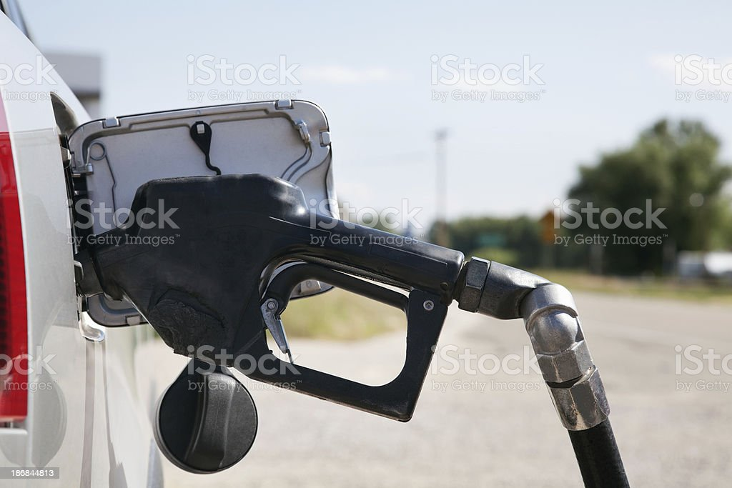 Gasoline lever handle pumping gas into Car royalty-free stock photo