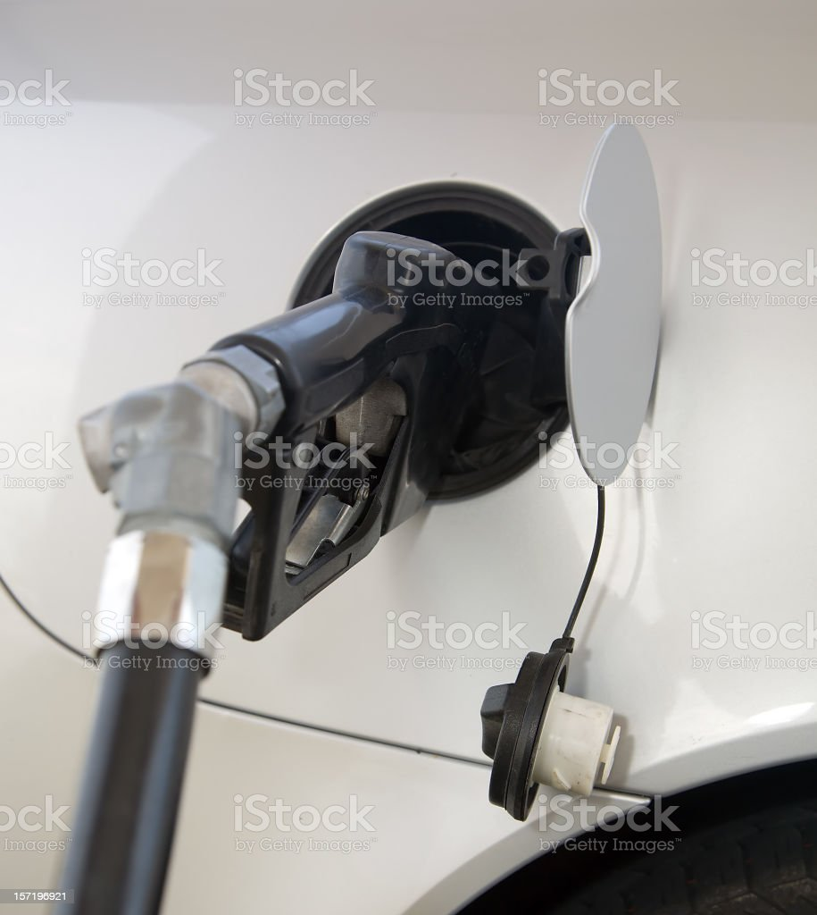 Gasoline Nozzle Filling Car royalty-free stock photo