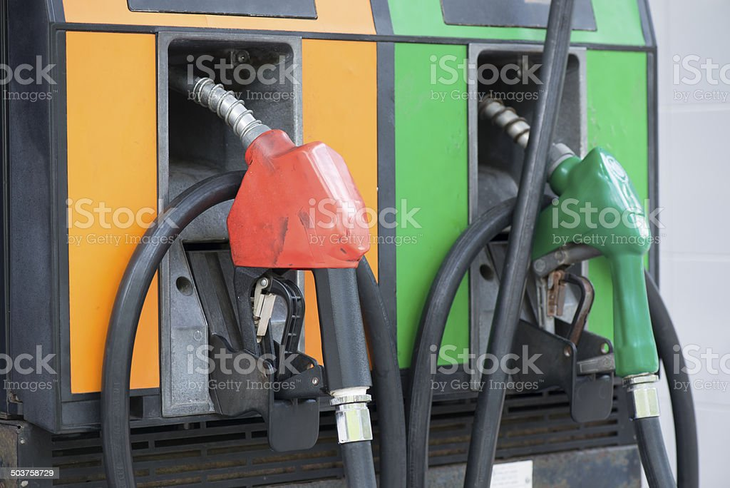 Gasoline nozzle in gas station. stock photo