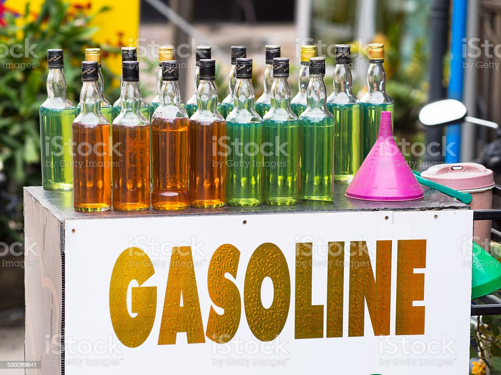 Gasoline on whisky bottles in Thailand stock photo
