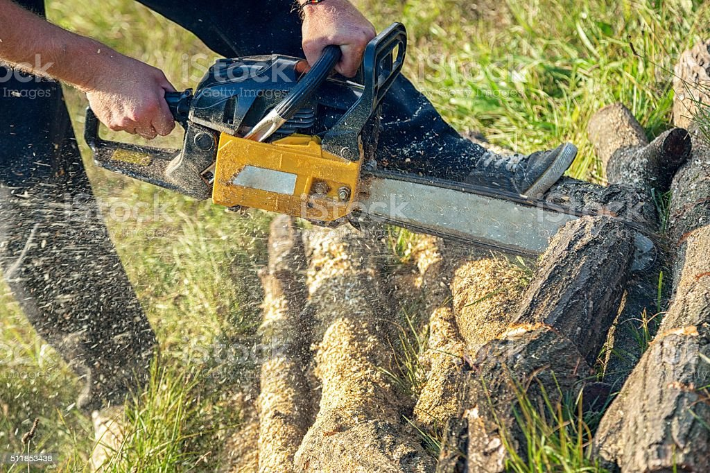 Gasoline powered professional chainsaw stock photo