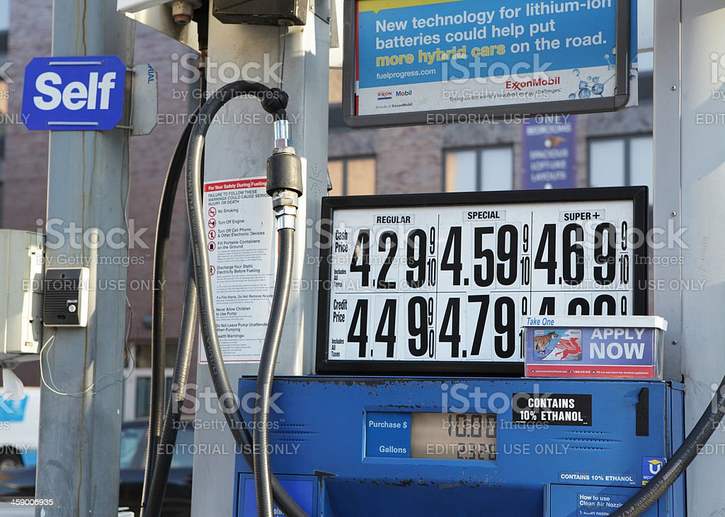 Gasoline prices and pump in NYC stock photo