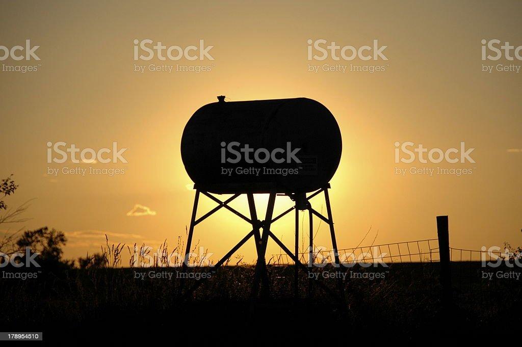 Gasoline tank at sunset royalty-free stock photo
