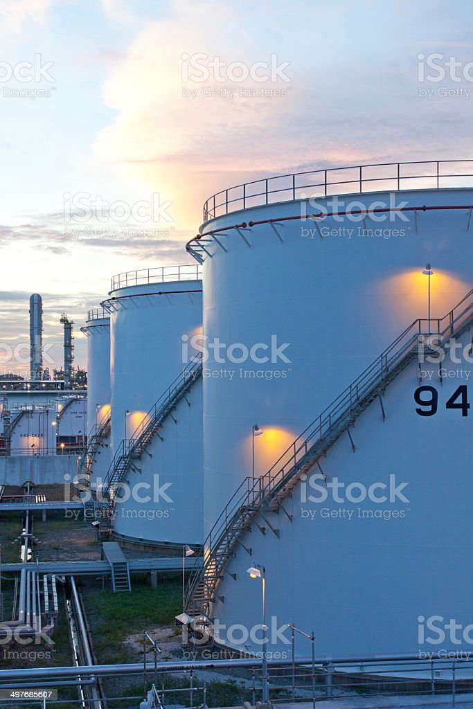 Gasoline tanks in the refinery plant in the morning time stock photo
