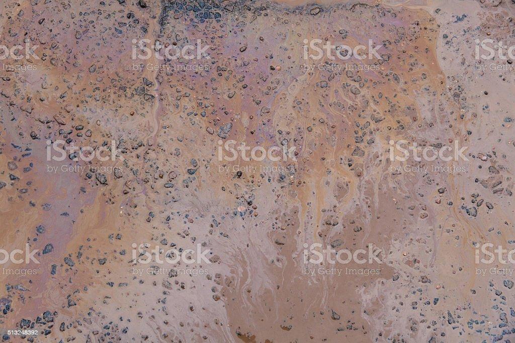 Gasoline texture on the wet asphalt stock photo