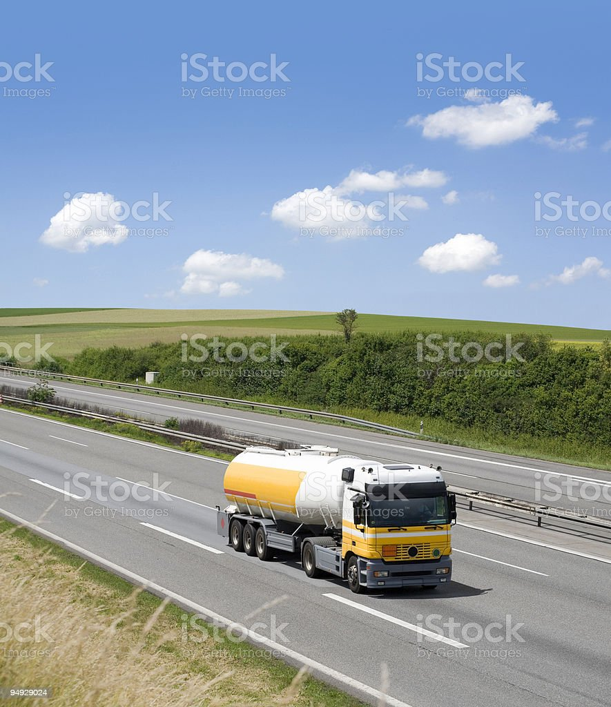 Gasoline truck driving alone on highway royalty-free stock photo