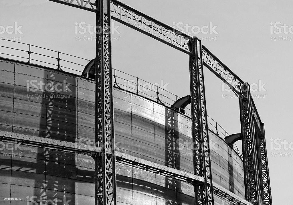 Gasometer in black and white at the sunset stock photo