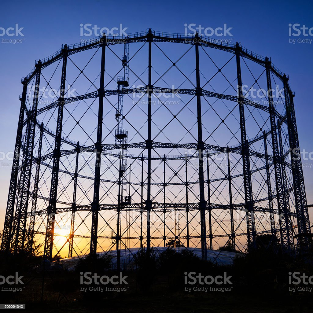 Gasometer structure at sunset stock photo